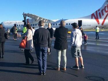 Пътници скачаха от самолет в Австралия заради фалшива бомба