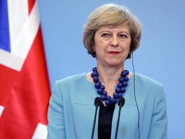 Тереза Мей застава на страната на САЩ в спора с ЕС за митата